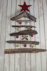 Close-up of Christmas tree made of wood and Christmas decoration